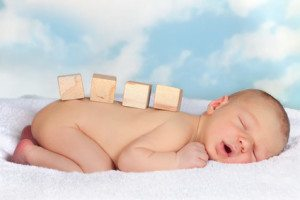 Wooden blocks on newborn baby